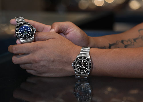 Photo of Rolex watch in hand